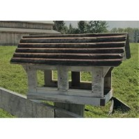 The fly-through Columbia Covered Bridge Tray Bird Feeder is a tribute to this staple of 19th Century engineering ingenuity. Perfect for any setting, this feeder is constructed of recycled and reclaimed wood with a metal non-removable roof. Finished with whitewashed outdoor paint. The large, open area can be filled with seed or can easily accommodate a piece of fruit for Orioles to enjoy. A custom-fit mounting plate makes installation to a standard wooden 4 x 4 or fence post.