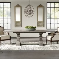 A traditional silhouette gets a rustic refresh with this rectangular dining table, the perfect pick for modern farmhouse arrangements. Crafted from solid and manufactured wood, this piece sports a weathered gray brown finish for an airy and understated look. The double pedestal dining table base features substantial turned legs.