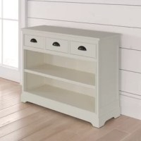 This classically shaped bookcase is accented with half-moon shaped drawer pulls, making it the perfect addition to any bedroom or living room as stylish storage or display space. A wide rectangular silhouette crafted of solid pine and MDF wood, with metal cup hardware, and four bracket feet. Two lower shelves are perfect for displaying photo albums and rows of your favorite reads, while three upper drawers offer out-of-sight storage for everything from batteries, to candles, to matchbooks. No...