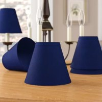 Interior design evolves over time. With the help of this traditional hardback empire shade set, so can your favorite lamp or chandelier! Crafted from cotton, this empire shade set can be used with most lamp bases, thanks to its clip on fitter. Each measuring just 6'' W x 6'' D x 5'' H, this mini shade set will bring a ambient glow to any lamp or chandelier in any room. We recommend cleaning by wiping with a clean dry cloth.