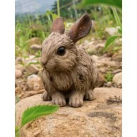 This unique rabbit statue will definitely turn heads with its driftwood composition. It can be used both indoors and out. Finely detailed craftsmanship.