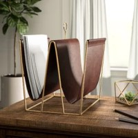 Rescue your paper and file folders from their usual pile and move them into a clean, organized space thanks to this metal and faux leather file holder. Measuring 13.5'' H x 12'' W x 11'' D and featuring two compartments, it's the perfect size to help organize your office, kitchen, or any room in need of a better clutter control system. Its combination of brown and gold hues provides a decorative accent ideal for traditional abodes.