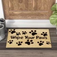 We might walk all over a door mat, but that doesn't mean it can't stand up for your home's style! This piece, with its text print and paw motif, is a fun touch for any pet-loving home. Crafted from a natural coco fiber with a vinyl base, this piece is great for catching dirt and mud from boots (and paws, of course). To help keep this piece in place, we recommend adding a rug pad.