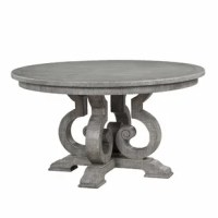 Combining classic and contemporary elements, the bold curves of this Dining Table provide both an elegant contrast and a unique look to any dining area. The beautiful round pedestal table features a wood base with decorative scrolled motifs in a