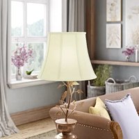 If something's feeling a little stale in your home, it could be your lampshades. Believe us or not, sometimes refreshing your home's look is as simple as flipping the switch on a fresh shade. For example, this 14'' bell shade is a great option for adding curved look to your luminary for a perfect traditional touch. Crafted from silk, this piece caps a variety of lamps with eye-catching style. A metal spider fitter in a brass finish completes this shade. When it comes to table lamps, we're all...