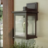 With its clean lines and understated solid finish, this one-light outdoor wall lantern puts a contemporary twist on a traditional design. Rated for use in wet locations, this fixture features a rectangular backplate and a boxy shade in a neutral finish that can complement most color palettes. Seeded glass panels make up the shade for a hint of vintage inspiration. Since the bottom is left open, you can easily change out the compatible 100 W medium-base bulb (included).