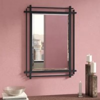 This mirror in the antique forged iron finish offers strong verticals and horizontals outlining the elegance of this reflective piece. Modern and industrial elements meet in this accented mirror, featuring an overlapping silhouette in an aged forged iron finish for understated appeal, to help open up your space and make a room feel brighter.