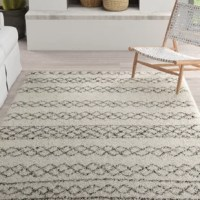 The cure for the bare floor blues, area rugs set the tone for your decor while adding barefoot-friendly comfort. This design features loosely-rendered geometric patterns in hues of cream and black that give it bold boho appeal. Crafted from polypropylene, it features a 1.5'' pile height, making it a perfect pick for laying out in the master suite or crafting a welcoming vignette in the entryway. No matter where you layout this design, we recommend using a rug pad for added traction.