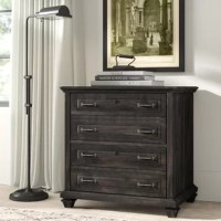 Traditional style gets a modern farmhouse update in this handsome two-drawer lateral filing cabinet. Crafted of pine hardwoods in a weathered woodgrain finish, this chest strikes a stately silhouette accented by crown moldings, raised paneling, aged bronze hardware, and four spade feet. Set on metal ball bearing glides, two lockable file drawers offer plenty of storage space for folders and documents, while the smooth top surface provides a perfect platform for a desktop organizer, framed...