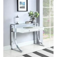 Add an edge of contemporary flair to any living space. This sleek, stylish writing desk exudes glamorous appeal. Its eye-catching frame is expertly crafted with a gracefully curved silhouette. Its gorgeous, glossy white surface blends appealingly with its shiny chrome legs. Complete with two felt-lined drawers with full extension glides, this desk enhances any home office with convenience and modern style.