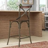 Complete your kitchen counter seating with this 25.4'' H bar stool, a perfect pick for both rustic and modern farmhouse abodes. It features powder coated steel framework, with tubular legs, arched half-moon supports, and X-shaped back for added interest. Its manufactured wood seat and back accent provide a neutral yet rustic finish to complete the look. It features a footrest for comfort, and accommodates weights of up to 200 lbs.