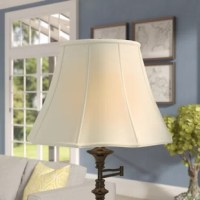 The traditional bell-shaped lamp shade gets an upgrade with a subtle scalloped flare at the bottom. Made of tailored silk-type shantung fabric with an off-white softback lining to create a warm, soft glow. The Silk Bell Lamp Shade is part of the Timeless™ Basic Shade Collection. Our multiple shade lines exemplify handcrafted quality and value. Height is measured by slant height from top to bottom of the lampshades' front face. Measurements listed as (TOP x BOTTOM x HEIGHT). Please measure...