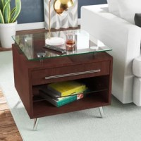 Whether sidled up beside your sofa or acting as a nightstand in the master suite, this end table is always a stylish stage. A cube frame, featuring one drawer and one shelf, is crafted from wood, with a tempered glass top. A square top provides the perfect perch for a gleaming lamp or a stack of glossy magazines. This piece measures 24'' H x 26'' W x 24'' D. This item requires assembly upon arrival.