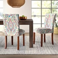 Combine the classic silhouette of the Parsons chair with a vivid paisley pattern, and what do you get? This chair! Perfect for rounding out any eclectic space or livening up a dining room table arrangement, it showcases bright hues of blue, red, and green. Founded atop hardwood legs, its armless frame is wrapped in polyester blend upholstery that's easy to clean in case of spills, while felt footpads protect your floors from scratches and scuffs.
