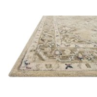 This traditional hooked rug expertly crafted of 100% wool in India. A soft and modern approach to a traditional design, with wisps it provides a versatile that feels incredible underfoot and looks timeless in any room.