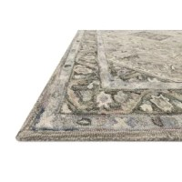 This traditional hooked rug expertly crafted of 100% wool in India. A soft and modern approach to a traditional design, with wisps of variegated colors, it provides a versatile that feels incredible underfoot and looks timeless in any room.