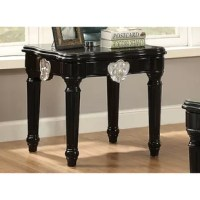 Dramatically revamp your home interior with this traditionally styled end table, made up of using quality wood. It is square and has a contrast carved motif turned legs providing a beautiful vintage look. Featuring complete black shiny finish along with silver color motif, this end table is an incredible inclusion to add the at-home setting. The flat tabletop can be used to serve its purpose to the most. Does not include any featured product other than one end table.