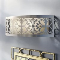 Bathroom remodels come in many forms, but across all of them, one thing remains the same: Lighting matters. Layers of lighting turn tiny washrooms into statement-makers and large-scale bathrooms into spa sanctuaries. Take this vanity bar light for example: defined by detailed openwork and a traditional flair. This glam-inspired luminary adds a touch of simple sophistication to your space. It accommodates three incandescent lightbulbs of up to 60 W each (bulbs not included).