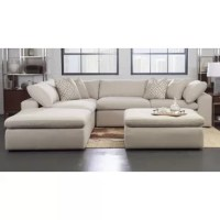 This sectional exudes plush comfort and extreme contemporary styling. Padded seat tops and overfilled back cushions sit between wide, straight arms.