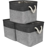 Keep clutter under control in style with this three-piece set of fabric cube storage bins! Enveloped in color-dipped fabric upholstery, each bin strikes a simple cube-shaped silhouette. Its open top makes it easy to stow away magazines, toys, folded blankets, and more, while chunky braided rope handles in metal grommets make transport a breeze. Measuring 13.25