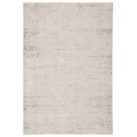 A neutral tone-on-tone colorway and tribal geometric patterning combine to create this power-loomed area rug's global appeal. Lustrous for a luxe touch, the viscose and polyester blend lends an incredibly soft high-low feel to this sleek ivory and gray accent.