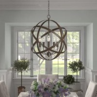 Showcasing an openwork spherical silhouette of overlapping circles, this five-light armillary chandelier brings a splash of contemporary style as it shines a light in any space. Suspended from an adjustable chain and a sloped-ceiling-compatible canopy, this metal fixture sports a solid metallic finish that's versatile enough to complement a variety of color palettes and aesthetics. A tier of five 60 W candelabra-base bulbs (not included) sits exposed within to offer a boost of brightness.