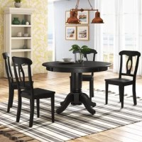Enjoy the company of family and friends around the Gaskell 5-piece Traditional Height Pedestal Dining Set. From the unique Napoleon-style chair design, to the pedestal tabletop beveled edge, and the carved details at the table base, this set features beautiful wood detailing which will be sure to catch your eye. Thanks to it's round design and traditional height, this small space dining set can easily sit four people comfortably; making game nights, casual meals, and entertaining fun and...