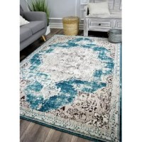Warming up hardwood and tile floors while setting the stage for the rest of your ensemble, area rugs are essential for nearly any room in your home. Power-loomed in Turkey, this Persian-inspired piece is made from polypropylene, a synthetic material designed to stand up to high traffic areas in your abode. It features a 1
