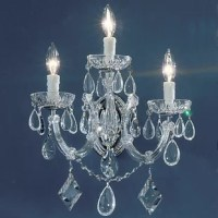 This series depicts a new twist to the traditional Maria Theresa look. Utilizing the standard frames but trimming them with contemporary crystalique crystal oysters, kites, and tear drops, up-dates the Maria Theresa style chandeliers. The overall effect is quite stunning and will fit many of today's more modern decor. To achieve a lower price point, the rosettes and panels are made of high quality acrylic rather than the traditional glass.