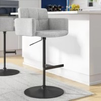 Sitting at the perfect height for kitchen islands, breakfast bars, and pub tables, barstools have a leg up on other seating options. Take this bar stool for example: perfectly suited for your home's contemporary aesthetic. It features a low back design, built-in footrest, a 360-degree swivel capability, and a hydraulic lift adjustable height. The frame of this seat is crafted from metal, in a black finish, with gray polyester upholstery. It requires some assembly upon arrival.