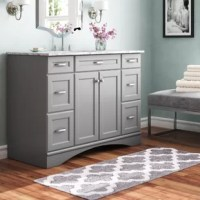 Rounding out our bathroom ensembles while also providing much-needed storage space, vanity sets are a must-have item in our decor. Take this one for example. It features six drawers that offer plenty of room to tuck away toiletries, while a two-door cabinet lends even more storage space. The Carrara marble countertop arrives with an included basin, saving you a trip to the store, and as an added bonus, this product comes backed by a one-year warranty.