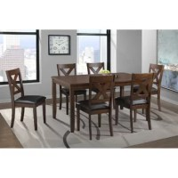 This 7 Piece standard height dining set is the perfect addition to your dining room. This set includes a table and six side chairs. The rectangle table shape will easily fit in your dining room. The chairs feature an x-back design and the seats are upholstered in a faux leather fabric; adding extra flair to this set. The foam cushion seats will keep you comfortable during long dinners. The set is finished in a pairs perfectly with the faux leather upholstery on the chairs.