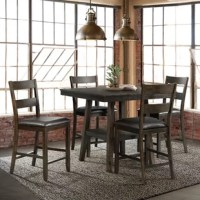 This 5 piece dining set is ideal for small space living. This counter height set includes a table and four chairs. The table features a square design and comes with a shelf in the middle. Use the shelf to store away extra dishes or display your favorite decor piece. The side chairs come with an upholstered seat and a ladder back design. The chairs cushions come in a fashionable, faux leather chocolate that pairs well with the dark walnut finish. Add this dining set to your home today for an...