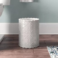 Kids driving you nuts leaving their bathroom in disarray? Maybe you just don't love a wide splattering of germs? This waste basket is here to help. Made of ceramic material with a vined floral pattern, it adds a touch of class to your space. Its neutral hue allows it to blend effortlessly with your decor while adding convenience to any room. At 11.75'' H x 9.25'' D, it's the perfect size for your space.