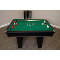 To enjoy playing billiards with your loved ones, bring home the 4.5' Bumper Pool Table with Accessories. It has a green playing surface and black finish frame that gives it a nice appeal. The modern pool table is made from manufactured wood that enhances its strength and durability. It is a set that includes bumper pool table, two cues, 10 bumper pool balls, table brush and chalks with racking triangle. The table has pedestal legs with non-skid base that make it sturdy and firm on the floor. It...