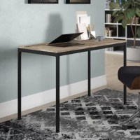 Whether tackling taxes or working on your next big novel, this writing desk is here to help. Defined by clean lines on its rectangular frame, this piece is crafted from manufactured wood and metal. Awash in a black finish, its metal frame showcases four squared legs, while the gray hue of its smooth top offers to blend effortlessly with a variety of different color schemes. Plus, after assembly, this product can support up to 110 lbs.