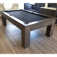 This Fulton Slate Pool Table exudes a monolithic footprint. As if it was carved from a solid block, its foundational strength rests on a straight leg with a straight apron. Its lines are clean and simple, perfect for traditional or transitional decor. Add a dining top to complete the functionality. The parson's style table has been a timeless design since the 1930s and the table perfectly captures the lines and scale of the minimalist parson's concept.The unique shadow gray finish on solid...