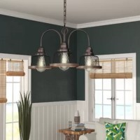 As much a work of art as a lighting fixture, chandeliers elevate the look of any space. This chandelier is perfect for an entryway in need of a little illumination, a staircase seeking brightening, or a kitchen island searching for some shine, this versatile luminary is the perfect pick to add a touch of traditional-style wherever you install it. Three lightbulbs of up to 100 W each (bulbs not included) are behind each metal shade. Dimmable, this chandelier is also compatible with sloped...