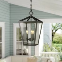 Suited for illuminating the front porch or casting a warm glow over alfresco dinners on a covered patio, this pendant is the perfect pick. Designed to live in damp environments, like those outdoors, it is crafted from weather-resistant metal that doesn't mind a little UV light or rain. Taking on a tapered lantern design, it features four candelabra-inspired lights inside shining under a clear glass shade. Measures 17.5'' H x 10'' W x 10'' D.