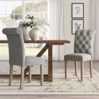Whether letting you pull up to a meal in style, or rounding out your seating ensemble, a chair like this is a great option for a touch of French countryside style. Crafted from a pine wood frame and upholstered with a polyester blend, each seat in this set of two features a high, rolled back, along with diamond button tufting. The feet of these chairs feature felt caps to help protect your floors from scrapes and scratches.
