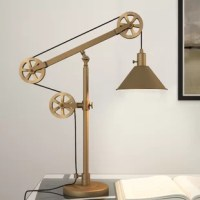 Fusing function and factory flair, this desk lamp is sure to spark conversation as it shines a light down on any tabletop. Crafted from metal, this statement piece features an industrial-inspired pulley system so you can adjust its height to suit your task. Though its distinctive, this lamp sports a solid finish that's versatile enough to blend with a variety of color palettes and aesthetics. A cone-shaped shade completes the look with vintage appeal, directing light downwards.