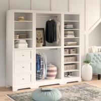 """The ultimate in closet organization, this three-piece set is crafted from solid and manufactured wood in a neutral white hue with brushed nickel hardware for a traditional look. The three-piece wall unit consists of one 25"""" W unit with drawers and adjustable shelves, a 36"""" W unit with both an upper and lower hanging area, and a 25"""" wide unit with eight shelves. Each piece features adjustable levelers that can be accessed from the base, allowing easier installation in tight areas."""