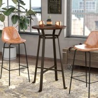 Suited for lofts and small-scale apartments alike, this compact pub table is a perfect pick for rounding out your seating ensemble! Its simple base is crafted from metal and features an x-brace for both style and stability, while a round solid wood top showcases an unfinished look with natural grain and burl detailing. Measuring just 41'' H x 23.62'' L x 23.62'' W, this must-have piece comfortably seats two for cocktails, brunches, and beyond.