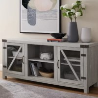 Design your living space with additional storage space by incorporating this TV stand. This stylish, rustic farmhouse TV stand blends with a modern aesthetic by featuring glass cabinet doors. Metal hinges and corners accent beautifully with the manufactured wood, laminate construction. With a versatile design, you can use it as a storage cabinet in your bedroom, buffet in your kitchen, or entertainment center in your living room. Keep your media, books, collectibles, décor, and more on the...