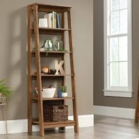 Bring a touch of traditional charm to your living room, den, bedroom, and beyond, while providing a place to perch potted plants, framed family photos, and more with this stylish ladder bookcase. Crafted from wood, it features five shelves of varying depth for keeping your collection of novels, accent pieces, you name it. And with a solid neutral finish, it's designed to complement nearly any color palette.