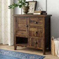 A classic farmhouse design gets a rustic refresh with this clean-lined accent cabinet. Crafted from solid acacia hardwood, this piece sports a neutral finish with distressed details for a weathered look. Three drawers, one single-door cabinet, and one open shelf provide essential storage space for clothes, office supplies, or any odds and ends strewn about your abode. This compact design fits easily in any room.