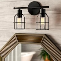 Marrying modern and industrial elements, this two-light vanity light brings a taste of what's trending as it illuminates your powder room. Crafted from metal, this fixture features a round backplate, a horizontal arm, and a pair of wire cages in a versatile solid finish that blends easily with a variety of color palettes and aesthetics. Two compatible 100 W medium-base bulbs (not included) sit exposed within for even more factory flair.