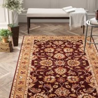 Warming up hardwood and tile floors while setting the stage for the rest of your ensemble, area rugs are essential for nearly any room in your abode. This one, for example, is ideal for areas with high foot traffic – especially in homes with little ones and four-legged friends running around. Its Persian-inspired deep maroon and golden pattern provide a traditional foundation for your arrangement.
