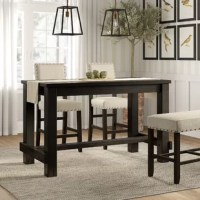 A clean-lined contemporary design gets a dash of well-worn character with this counter-height pub table. Crafted from solid wood and veneers, this piece measures 36'' H x 60'' W x 30'' D to comfortably fit four. An antique black finish gives it the versatility to blend with any color palette you pick, while a wooden beam running down the center underneath offers a distinctive dose of farmhouse flair. Assembly is required.