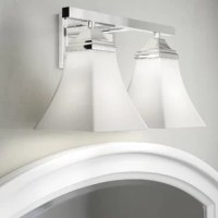 Bathroom remodels come in many forms, but across all of them, one thing remains the same: Lighting matters. Layers of lighting turn tiny washrooms into statement-makers and large-scale bathrooms into spa sanctuaries. Take this vanity light for example: Taking cues from both classic and contemporary designs, it showcases a clean-lined backplate and straight arm awash in a metallic finish, while two bell-shaped shades direct light in either up or down orientation. Whichever way you choose, it...